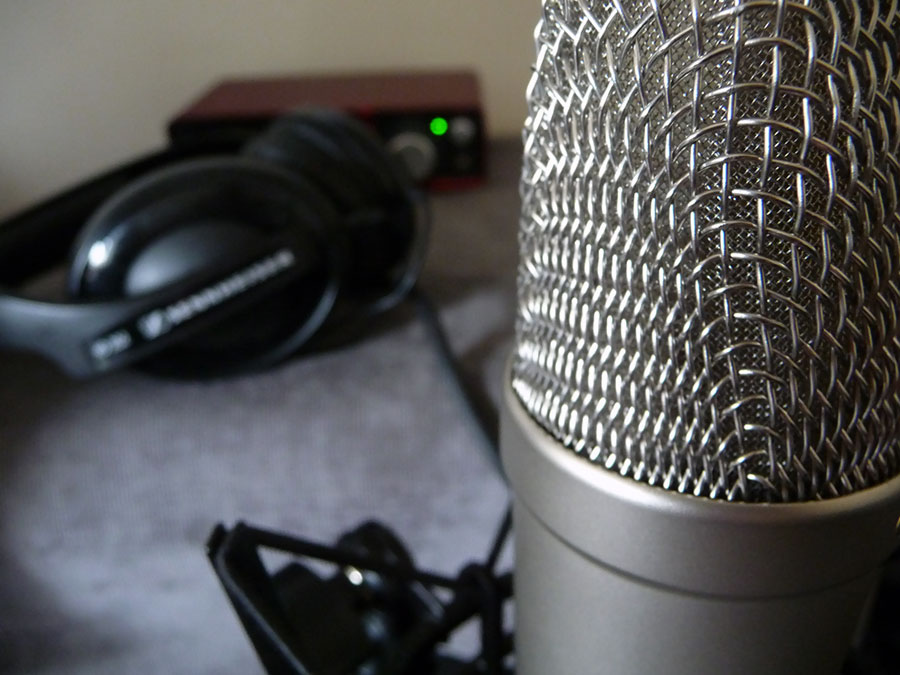 microphone-with-headphones-in-background