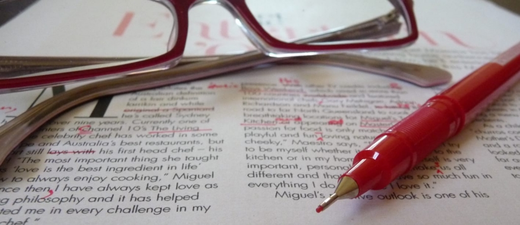 Proofreader red pen on copy